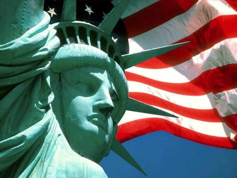 Memorial Day 2020 Picture of Statue of Liberty with US Flag waiving behind it